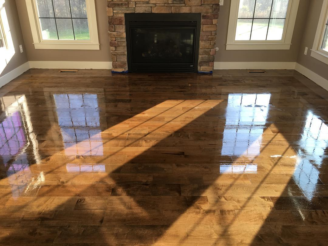 Well, we think you've waited long enough. A few weeks ago we posted a photo of a project that we started out at Watermark. Here's a finished photo. #oldtogold #grandrapids #michigan #grmi #watermark #watermarkcountryclub #new #fresh #highend #hardwood #flooring #hardwoodfloors #maple #bona